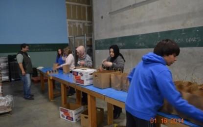 Pacifica volunteers sorting food donations for Feeding America in San Diego